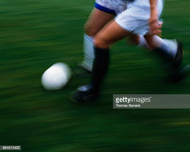 Soccer Players Chasing Ball