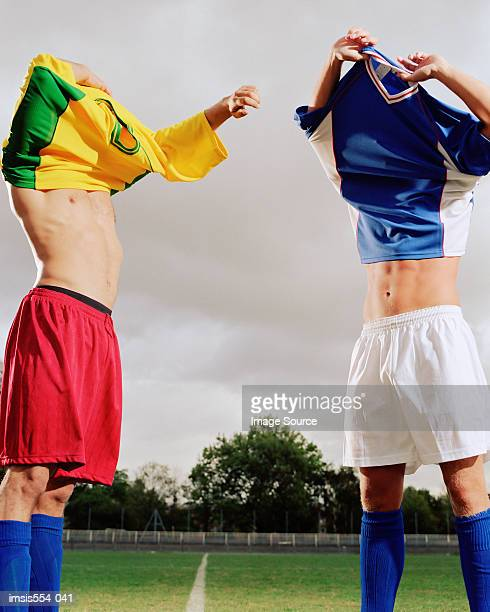 Soccer players exchanging t-shirts