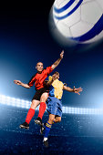 Soccer players fight in the air