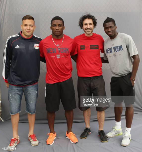 Soccer players for the New York Red Bulls Santiago Castano Ambroise Oyongo Marius Obekop and Cofounder of Grassroot Soccer Ethan Zohn participate in...