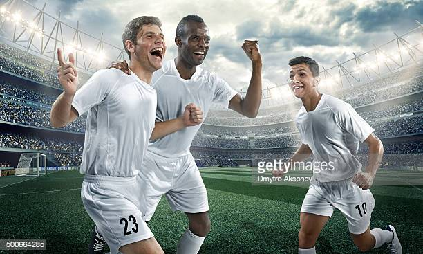 Soccer players happy scoring a goal