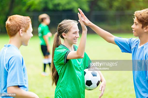 Soccer players high five after game
