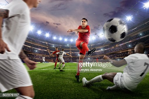 Soccer players in action on soccer stadium