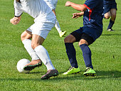 Soccer players in action outdoors