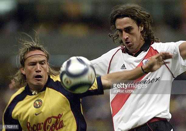 Soccer players Luis Hernandez and Matias Lequi are seen fighting for the ball in Mexico City 13 March 2002 AFP PHOTO/Jorge UZON