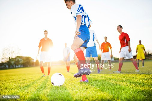 Soccer players on playing field.