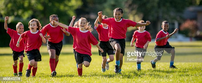 Soccer Players Running and Cheering