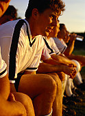 Soccer Players Sitting on a Bench