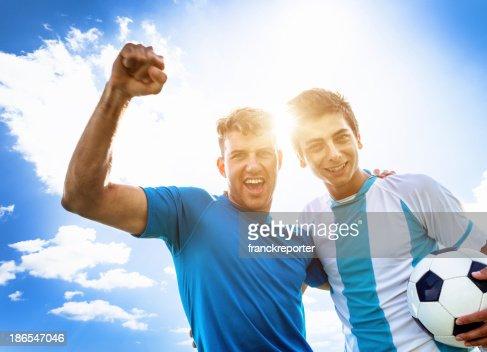 Soccer players winning : Stock Photo