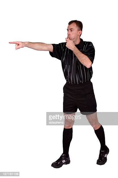 Soccer referee blowing whistle and  pointing