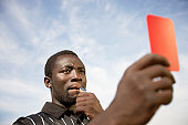 Soccer Referee Holding Out a Red Card
