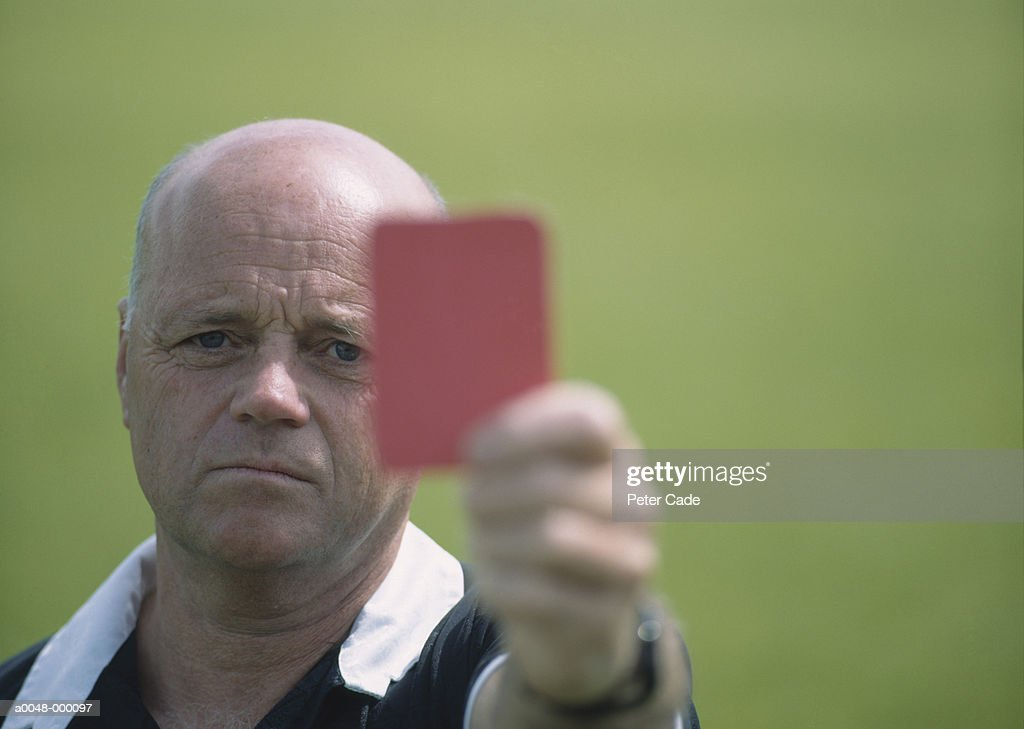 Soccer Referee Holds Red Card : Stock Photo