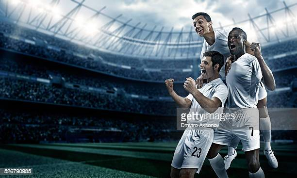 Soccer stadium and soccer players happy after victory