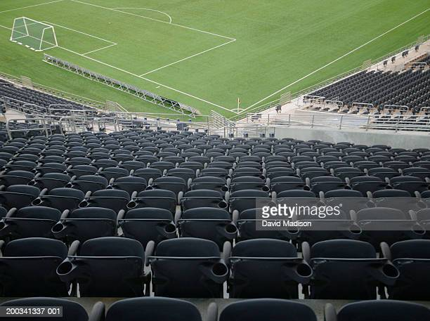 Soccer stadium with empty chairs, soccer goal and corner flag