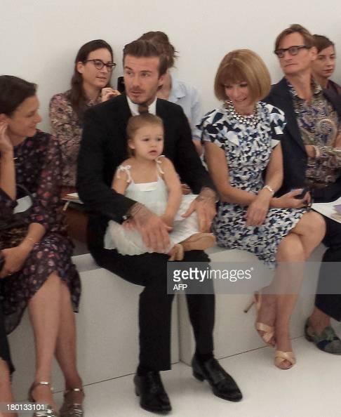 Soccer star David Beckham with daughter Harper and celebrity editor of Vogue Anna Wintour watch as designer wife Victoria Beckham unveils her new...