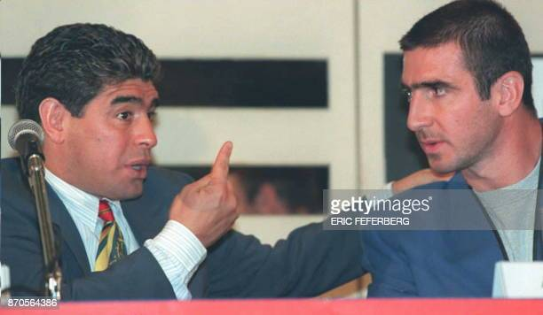 Soccer star Diego Maradona of Argentina talks to French player Eric Cantona during a press conference in Paris 18 September during which he unveiled...