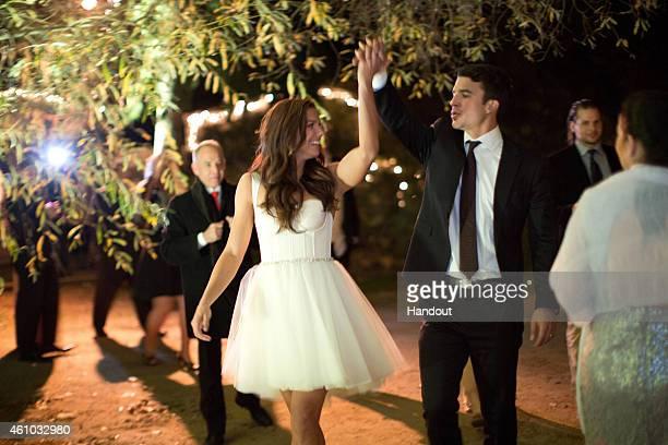 US Soccer stars Alex Morgan and Servando Carrasco celebrate at their wedding reception at Rancho Dos Pueblos on December 31 2014 in Santa Barbara...
