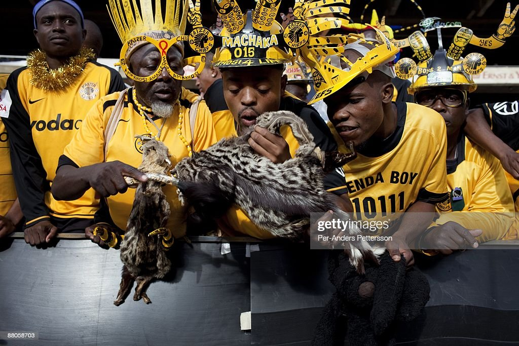 Soccer supporters for the local team Kaizer Chiefs use animal skins to help them win the game on May 2 2009 at Johannesburg Stadium Johannesburg...