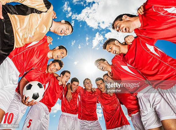 Soccer team against blue sky.