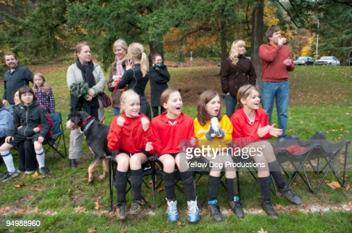 Soccer team and spectators cheering on sidelines  : Foto stock