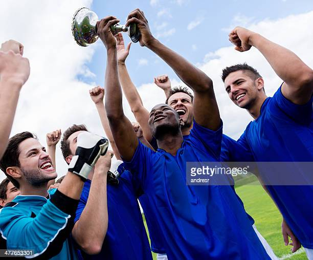 Soccer team celebrating a victory