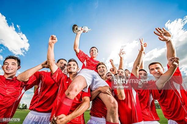 Soccer team celebrating.
