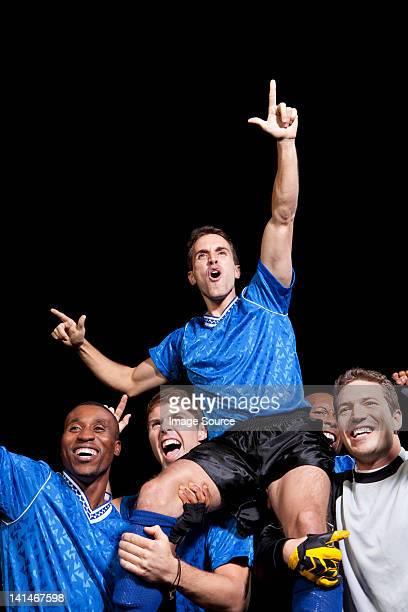 Soccer team celebrating victory