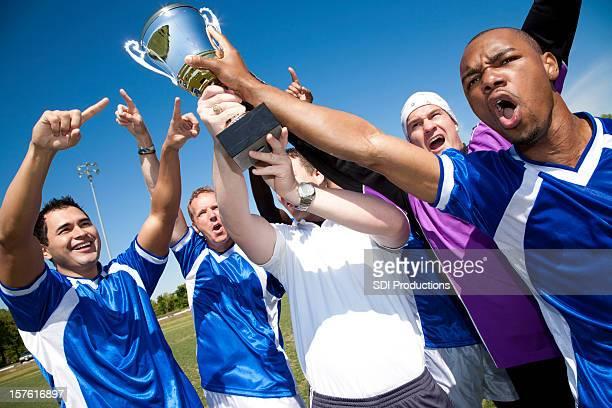 Soccer Team Holding Up Trophy Together after Victory