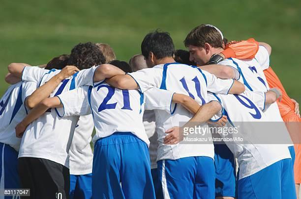 Soccer Team Huddling