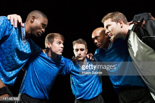 Soccer team planning game in huddle : Stock Photo