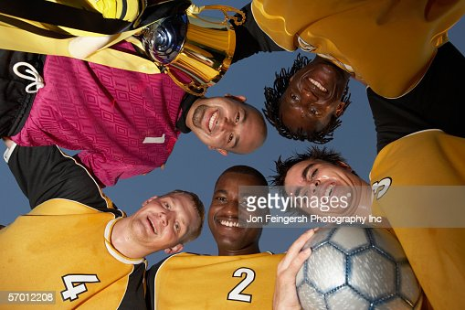 Soccer team posing in a huddle : Stock Photo