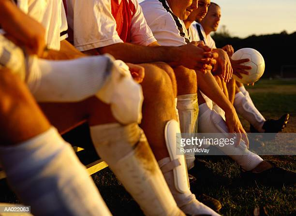 Soccer Team Sitting on a Bench