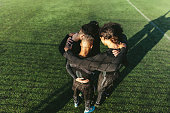 Five a side football team gathering before match. Young soccer team standing in a huddle.