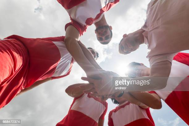 Soccer team with hands together
