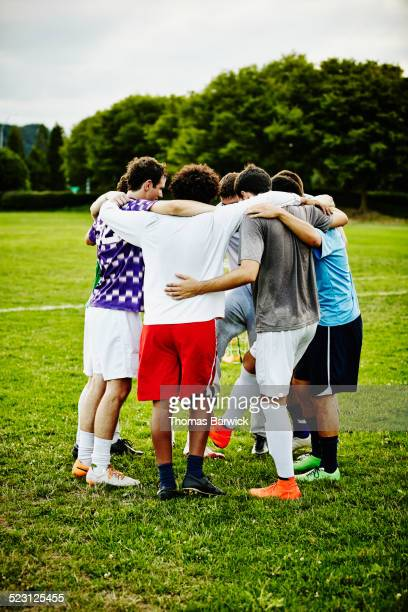 Soccer teammates in huddle after soccer game