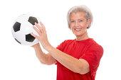 Senior woman with football