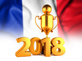 Sport Background with Sport Background with Golden Winner Trophy Cup and 2018 text against the national flag of France
