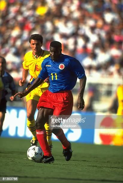 Soccer World Cup Colombia Adolfo Valencia in action vs Romania Gheorghe Popescu Pasadena CA 6/18/1994