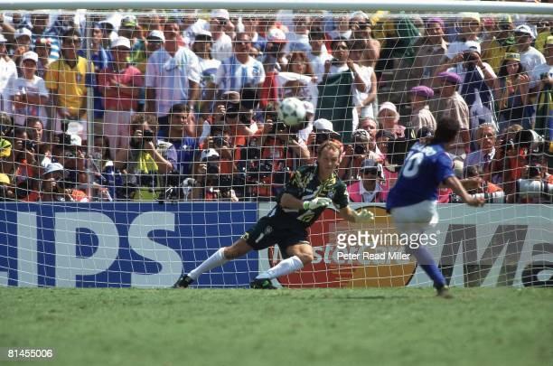 Soccer World Cup Final Brazil goalie Claudio Taffarel in action vs Italy Roberto Baggio Baggio missed penalty kick resulting in loss Pasadena CA...