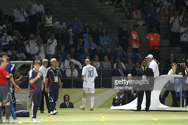 Soccer World Cup Final France Zinedine Zidane leaving field past trophy after red card from head butt vs Italy Marco Materazzi during game Berlin...