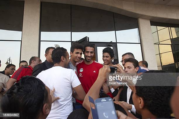 World Cup Preview Egypt midfielder Mohamed Aboutrika poses with fans outside of the hotel on the way to the team bus after practice session at June...