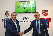 Soccerex CEO Duncan Revie left shakes hands with Major League Soccer Commissioner Don Garber during day five of the Soccerex Global Convention at...