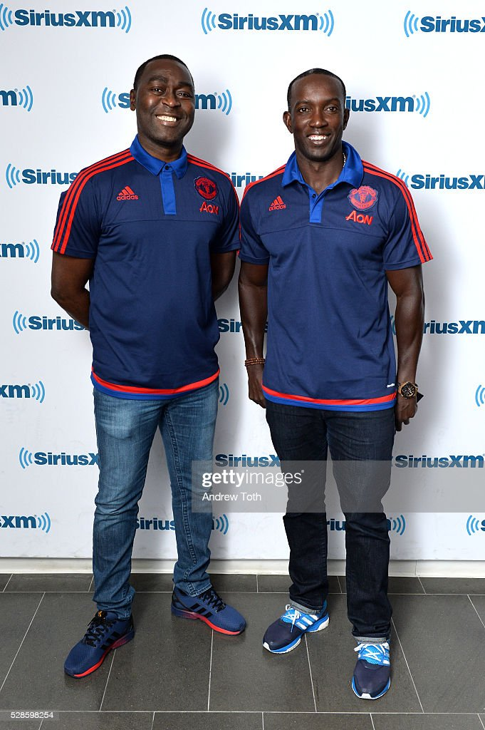Soccer/football players Andy Cole (L) and Dwight Yorke visit SiriusXM on May 06, 2016 in New York, New York.