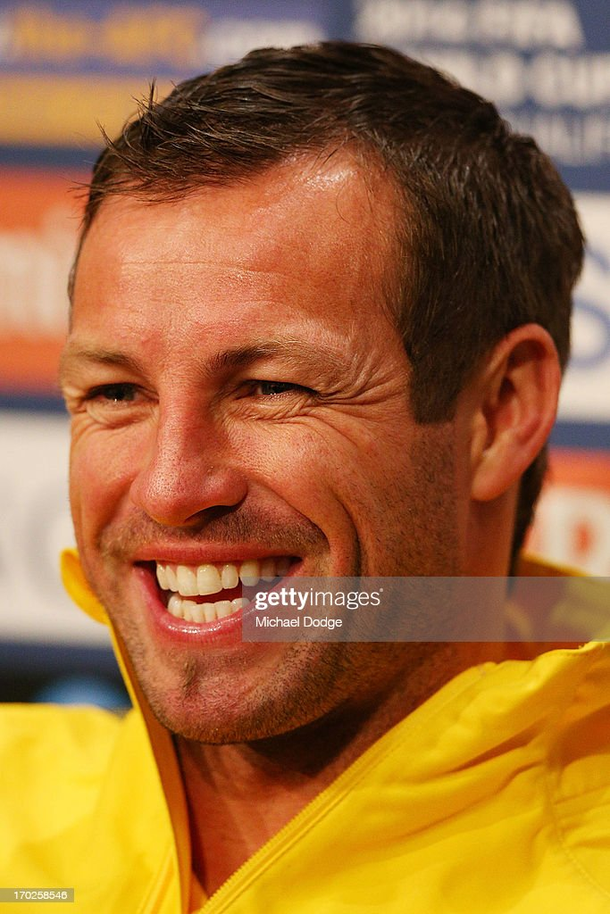 Socceroos Captain <a gi-track='captionPersonalityLinkClicked' href=/galleries/search?phrase=Lucas+Neill&family=editorial&specificpeople=213118 ng-click='$event.stopPropagation()'>Lucas Neill</a> reacts when speaking to the media during an Australian Socceroos press conference at Etihad Stadium on June 10, 2013 in Melbourne, Australia.