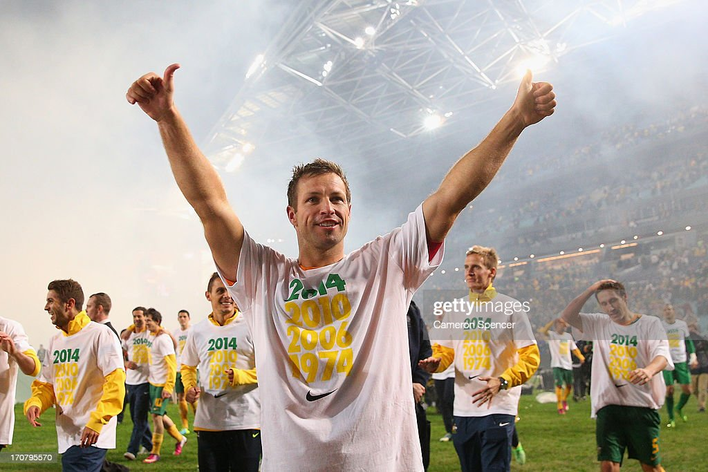 Socceroos captain <a gi-track='captionPersonalityLinkClicked' href=/galleries/search?phrase=Lucas+Neill&family=editorial&specificpeople=213118 ng-click='$event.stopPropagation()'>Lucas Neill</a> thanks fans after winning the FIFA 2014 World Cup Asian Qualifier match between the Australian Socceroos and Iraq at ANZ Stadium on June 18, 2013 in Sydney, Australia.