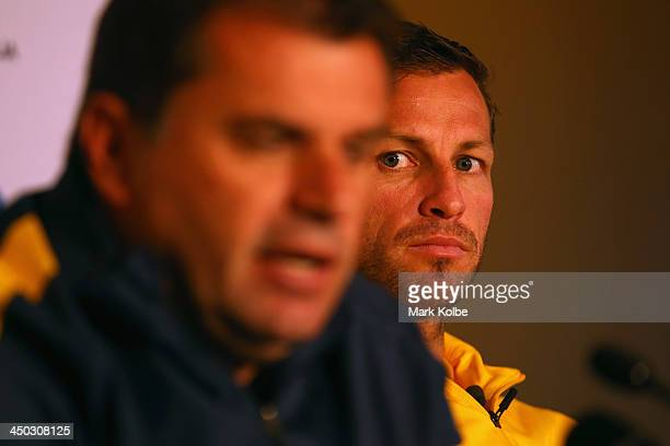 Socceroos captain Lucas Neill watches on as manager Ange Postecoglou speaks to the media at an Australian Socceroos press conference at the...