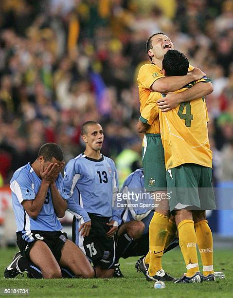 Socceroos captain Mark Viduka celebrates with team mate Tim Cahill after winning the penalty shootout during the second leg of the 2006 FIFA World...