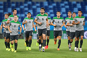Socceroos captain Mile Jedinak and team mates warm up during an Australian Socceroos training session at Arena Pantanal on June 12 2014 in Cuiaba...