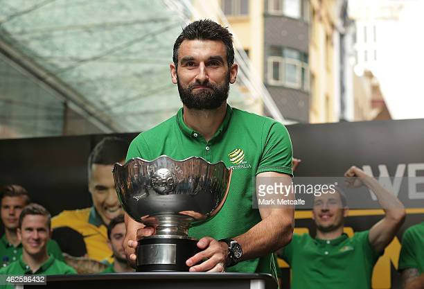 Socceroos captain Mile Jedinak holds aloft the Asian Cup during celebrations at Westfield Sydney on February 1 after the Socceroos won the 2015 Asian...