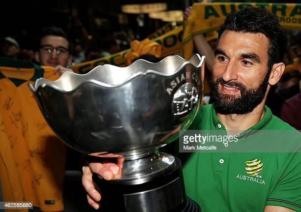 Socceroos captain Mile Jedinak poses with the Asian Cup during celebrations at Westfield Sydney on February 1 after the Socceroos won the 2015 Asian...